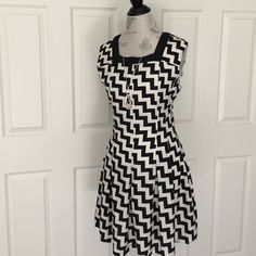 """Flash Sale Graphic Print NWT Dress HP 5/17Collective Concepts NWT Black and Cream graphic print dress. length is 36"""" and features side zipper and lightweight stretchy jersey lined body. 100% poly. purchased from Piperlime. **price is firm - just reduced** Collective Concepts Dresses"""