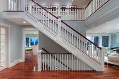 Great idea for the staircase. Get rid of the wall and add a rail to the basement stairs. I love the white and dark wood combo.