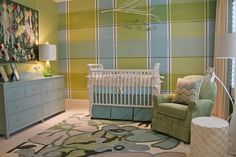 This nursery was painted with an accent wall in the colors of choice