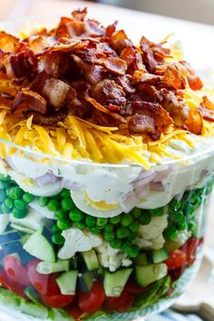 Seven Layer Salad. Classic Seven Layer Salad is always a party favorite! Seven Layer Salad. Classic Seven Layer Salad is always a party favorite! Salad Recipes Healthy Lunch, Salad Recipes Video, Salad Recipes For Dinner, Healthy Lunches, Chicken Honey, Seven Layer Salad, Mini Pizza, Southern Kitchens, Oreo