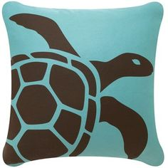 The modern design Tortuga pillow in Cocoa-Aqua is an homage to the wise ancient sea turtles populating the worlds oceans.