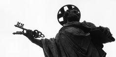 Statue of Saint Peter on top of Trajan column in Rome