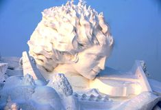 Snow Sculpture of Beautiful Lady  This is a big snow sculpture of a beautiful young lady in sun island park at Harbin Ice and Snow Festival