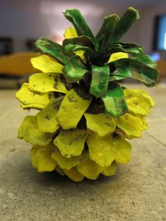 This craft was pure inspiration for my nutrition lesson.  I needed to come up with a pineapple craft but couldn't find an easy 3D one for preschoolers that I liked.  I took a pinecone and painted it.  Make sure to select a pinecone that stands.  It took less than 5 minutes to make.  Children need to be careful of sharp points on each scale.  Ages 4 & up.