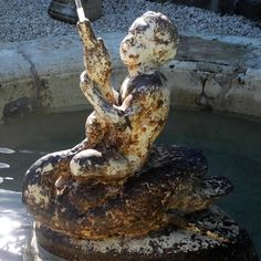 Love the child on a swan in the center of one of our French fountains! Details -  18th c. Stone Basin with 19th c. Iron Fountain Center from Property in Aix en Provence, France available at Chateau Domingue