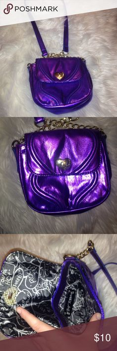 Betsy Johnson cross body purse It has a shimmery blue/purple color. A little fading under the flap but can't be seen when purse is closed. Betsey Johnson Bags Crossbody Bags