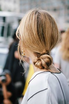 Danish blogger Pernille Teisbaek at NYFW with a low loose knot hair style.