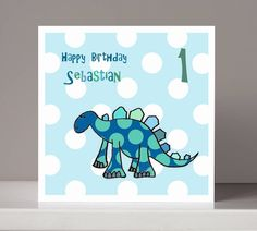 Make any little boy feel special with this hand illustrated dinosaur birthday card, which can be personalised to show his name and age. All my cards are sent first class post.If no personal details are provided, the card will read 'Happy Birthday'. Black speckles around the image are characteristic of this hand drawn technique. This design is available as children's birthday invitations. This card is blank inside for your own message and is printed on to card that has been manufactured from…
