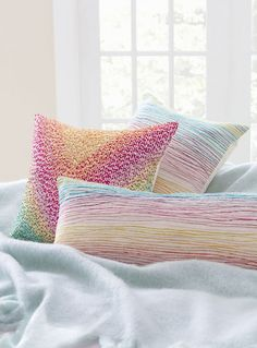 Fine detailing in fun colors, this cotton throw pillow is a work of textile art exhibiting exquisite craftsmanship and features hand embroidery in bright yarns. Aquarelle Embroidered Decorative Pillow