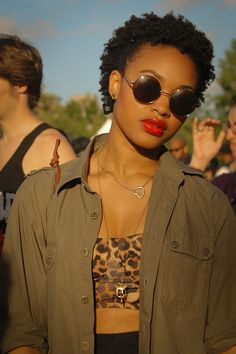 The red lips and leopard bando with army shirt and short #afro = summer lovin'