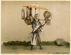 Seller of cakes dancing.  About late 19th century, Japan