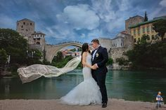 Most romantic wedding moments from Old Bridge in Mostar. With its magnificent architecture this place attracts many couples from our region and from around the world to choose this place for their wedding photos.  Read more on our website: www.tourguidemostar.com #bosniaandherzegovina #travel #traveltips #oldbridge #tourguidemostar #visitmostar #ovojeBiH #besttravel #photography #wedding