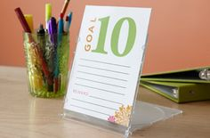 Tip: Create a cute and clever stand for your planner using a clear CD jewel case. Repurpose one you already have or purchase empty cases at an office supply store.