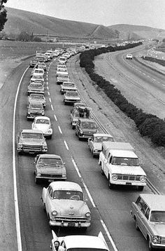 12/6/69, Altamont, CA — One solitary car head northwest on what is now I-580, as a monumental traffic jam-even by California standards-backs up cars for nearly 20 miles, as thousands of rock fans converge on a free concert by the Rolling Stones at Altamont Speedway, 50 miles southeast of San Francisco.