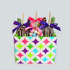 Large Easter Basket Includes 3 large apples, 4 gourmet pretzels and bag of malted eggs. Wrapped with our signature ribbon.  $58.00