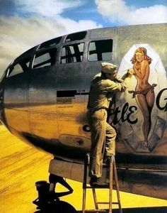 "chrisgaffey: "" U.S. Marine, Randall Sprenger, painting nose art on ""Little Gem"", a Boeing B-29 Superfortress at Isley Field, Saipan, Marianas Islands, February 1945. """