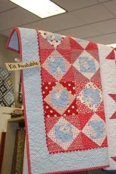 from American Quilting blog...the baby blue color is so cute with the reds! boys