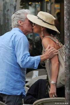 Pin for Later: Celebrities Love Showing Hot Summer PDA  Michael Douglas gave Catherine Zeta-Jones affection in Italy in July 2010.