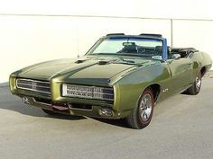1969 Pontiac GTO Convertible. Ya didn't see a lot of green GTO's back in the day. This one is a 400/turbo 400  4brl. 4:11                      `™`