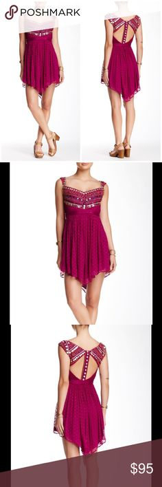 """🆕 Free People jeweled chevron mini dress fuchsia A trinket & bead embellished mesh bodice rests atop a ruffled skirt on this sleeveless V-neck mini with a cutout back. - V-neck - Sleeveless - Concealed side zip closure - Asymmetric hem - Approx. 30"""" shortest length, 40"""" longest length - Imported Fiber Content: Shell: 100% rayon Lining: 100% rayon Trim fabric: 100% nylon Fit: this style fits true to size. Brand new with tag. Retail price $350. Free People Dresses Mini"""