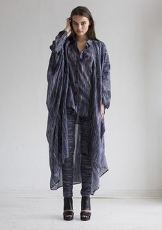 Agave Flicker is a draped ankle length caftan dress in cotton/silk chiffon. The caftan is draped around the body with the fabric stitched together at several points along the arms, leaving glimpses of skin in-between. It can be worn open as a caftan coat or, with the buttons fastened, as a dress. Team with a more relaxed garment, such as The Sweater, or layer it with the matching Flicker items, for a laidback and luxurious look.