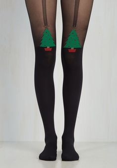Ten Out of Tannenbaum Tights. These black tights totally earn gold stars - like the ones sparkling atop festive trees!  #modcloth