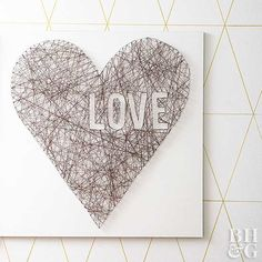String art looks complicated, but it's actually a fun project that comes together quickly (even with kids involved) and makes a great Valentine's Day gift. Paint a piece of lightweight wood your desired color. Trace a heart shape using a pencil, and stencil the outline of the LOVE or another word of your choosing. Tap thin nails along the lines of the shape and word, spacing them about 1/2 inch apart. Loop a thin yarn or string from nail to nail, across, up and down, and side to side, until…