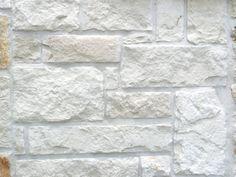 white limestone veneer - for the backsplash of kitchen and under bar.