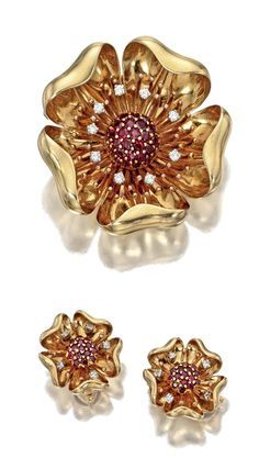 14 KARAT GOLD, RUBY AND DIAMOND FLOWER BROOCH AND EARCLIPS, TIFFANY & CO., CIRCA 1940. Each designed as a flowerhead with central domed cluster of round rubies, encircled by round or single-cut diamonds weighing a total of approximately .85 carat, signed Tiffany & Co., earclips numbered pat. 2423905.