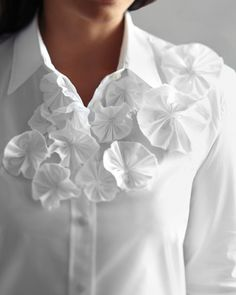 Upgrade a basic button-down shirt with easy fabric rosettes.