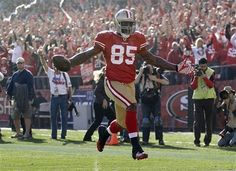 San Francisco 49ers tight end Vernon Davis (85) takes the ball into the endzone for a 49-yard touchdown against the New Orleans Saints in the first quarter of an NFL divisional playoff football game Saturday, Jan. 14, 2012, in San Francisco.