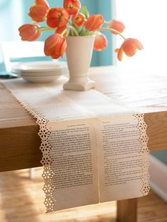 What a cute idea for a bridal shower table runner. How about old hymnal or bible pages.