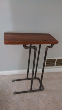 Barn wood & pipe end table / TV tray: Plained, cut, sanded, and stained barn wood. Washed pipes with water and dish soap to get grease coating off, put them together to make table base, and secured it to table top.