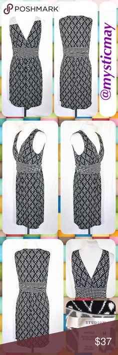 """Black Diamond Geometric Print Midi Dress Size M Sleeveless career dress from Studio M with a plunging v-neckline and a bold black and white diamond print throughout. Lightweight and stretchy with an empire waist. Falls just below the knee. Size Medium (M) or 8/10. Measures 18"""" across the chest and 37"""" in length. Looks Like New! Studio M Dresses Midi"""