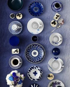 Mismatched blue and white cups,  saucers & plates