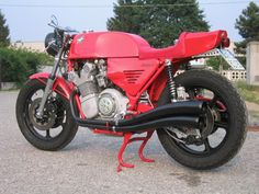 Motorcycle based on MV Agusta 4 cylinder  Modified parts:      Magni frame     aluminium fuel tank     racing saddle     6 spokes aluminium wheels     chain conversion kit     dry clutch kit     carburettors PHF 32mm     electronic ignition     exhaust kit