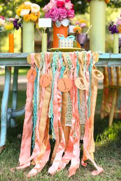 Super cute and colorful bohemian chair decor.  Photo by Aaron Snow Photography. www.wedsociety.com  #wedding #chairs