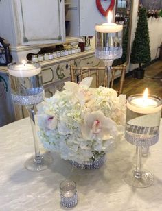 Sophisticated elegance with white hydrangea and white cymbidium orchids, and a touch of rhinestone detail on the glassware.
