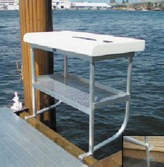 The Boathouse: a new definition to lakefront living! Fish Cleaning Table, Fish Cleaning Station, Floating Boat Docks, Floating House, Lake Dock, Lake Cabins, Lake Cottage, Lodge Decor, River House