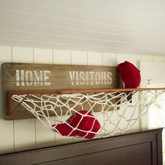 Sports Wall Horizontal Storage made from an old basketball hoop! So creative & fun!