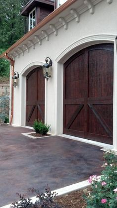We like the wood garage doors               Carriage House garage doors by C.H.I. #HomeBuildersinHouston