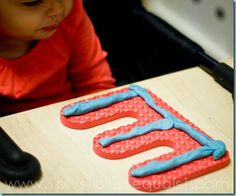 I love this idea! Use the letter from the large alphabet floor mats as playdough mats. Great way to save paper and having to print out mats. The kiddos will love these