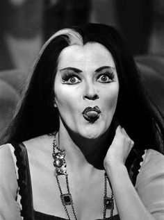 Lily Munster sticking her tongue out.