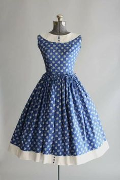 This Lanz Originals cotton dress features a white flower and heart print atop a blue background. Contrasting white cotton pique trim and ric-rac trim at neckline and hem of skirt. Vestidos Vintage, Vintage 1950s Dresses, Retro Dress, Vintage Outfits, Vintage Clothing, Pretty Outfits, Pretty Dresses, Beautiful Outfits, 1950s Fashion