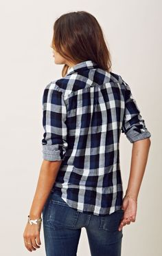 Gorgeous plaid flannel shirt. Sexy lady lumberjack with an advanced degree