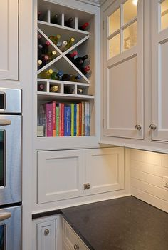 Organized to Perfection | Cultivate.com... would love an open slot like this for my cookbooks in the kitchen.. easy access and wine bottles