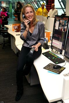 Multi-tasking! Holding two telephones simultaneously, The X Files star Gillian looked typically stunning for her day of charity supporting