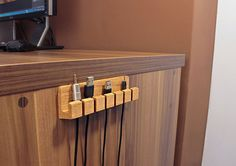 Need a handy and suitable way to manage your cables on your wood table? Take a look at the handmade wooden cable organizer, it may be a nice companion for your (diy desk decorations computers) Diy Computer Desk, Desk Tidy, Diy Desk, Desk Cable Tidy, Wooden Desk, Wood Table, Home Office Furniture, Furniture Design, Furniture Ideas