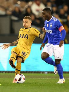 Kieran Trippier of Tottenham Hotspur and .Kwadwo Asamoah of Juventus FC compete for the ball during the 2016 International Champions Cup match between Juventus FC and Tottenham Hotspur at Melbourne Cricket Ground on July 26, 2016 in Melbourne, Australia.