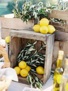 Wooden crates with lemons and olive branches for a beautiful orchard wedding look